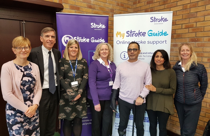 David Rutley MP with, l-r, Ms Bernadette Bailey (Eastern Cheshire Clinical Commissioning Group); Ms Cheryl Cooper (Eastern Cheshire Clinical Commissioning Group); Ms Jayne Humphreys (Stroke Association Support Coordinator, Macclesfield); Santokh (local stroke survivor), Nielam (Santokh's wife); and Ms Cathy Armstrong (Community Neurophysiotherapist)