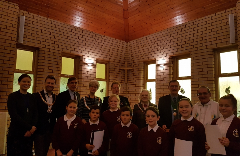 David Rutley MP with, front row, pupils from Christ the King Catholic and Church of England Primary School, and, back row (l-r), Mrs Heather Schofield, Cllr Adam Schofield, Cllr Liz Durham, Ms Lynn McGill, Cllr Lesley Smetham, Mr David Smetham, and Father Peter Cryan